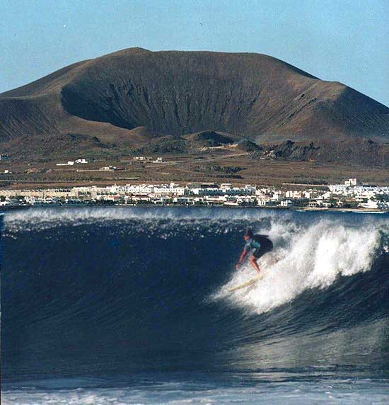Around 1990 I was lucky enough to live in the Canary Islands for a while this is a photo of me surfing a place called Lobos